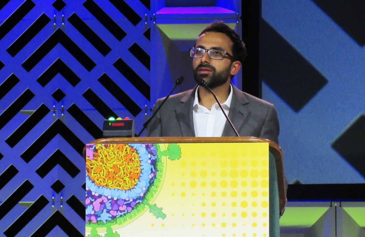 Ravindra Gupta first presenting the case at CROI 2019 in Seattle. Photo by Liz Highleyman.